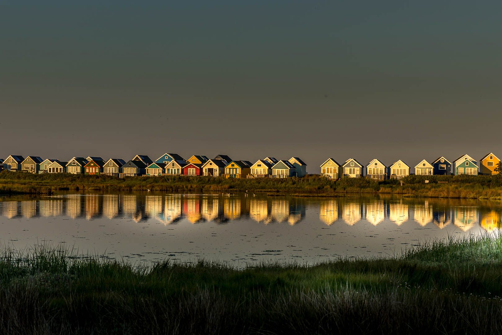Beach hut reflection
